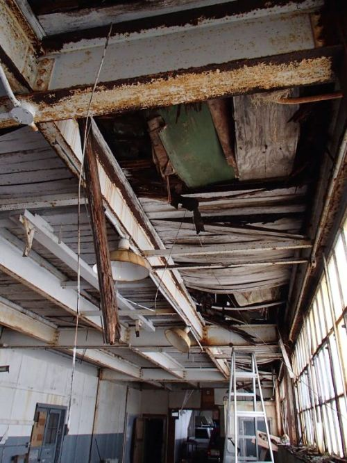 Here is what the second floor looks like for half the building.  The city is really going to restore this building?  Is ANYONE willing to actually fix this besides me?  Hell no.  If they say they would,  they are lying.