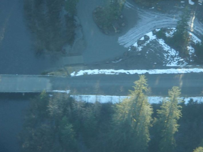 Fuzzy photo of the boat launch area after the water had dropped to 1600 CFS...  You can see the high water mark flooding the entire parking lot where the ice is gone.