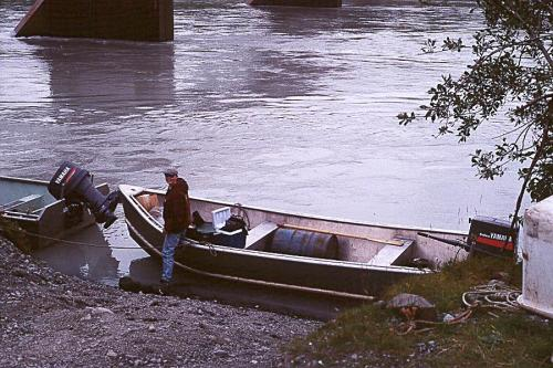 Teen holding the skiff at the Dangerous River - running supplies on the Dangerous because it was (slightly) cheaper than flying