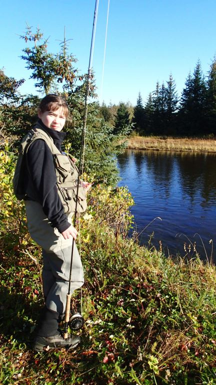 Eden showing off her first pair of Simms waders - that she'll outgrow in another week!