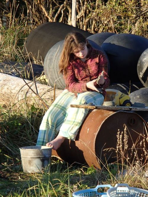 Eden making some clay pots from the local clay bank in the river