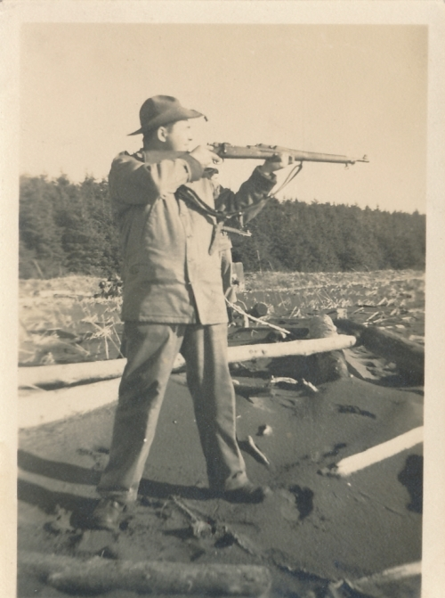 Soldier with rifle at Cannon Beach